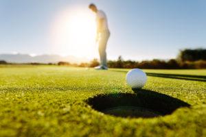 Man Putting golf ball   CBMC Golf Tournament Omaha